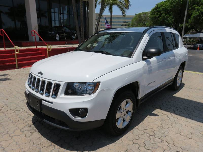 2015 JEEP COMPASS SPORT 4DR SUV white the showroom miami is a family owned first class used car