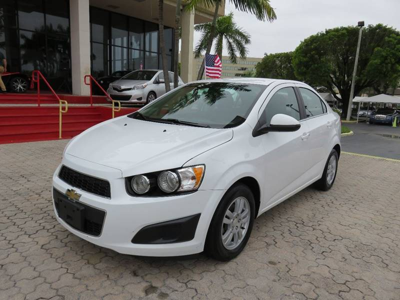 2014 CHEVROLET SONIC LT AUTO 4DR SEDAN white the showroom miami is a family owned first class us