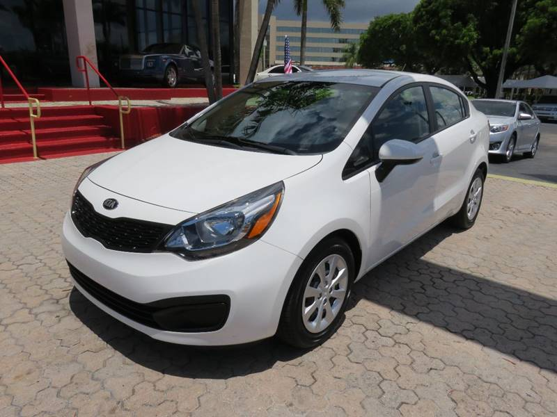 2015 KIA RIO LX 4DR SEDAN 6A white the showroom miami is a family owned first class used car dea