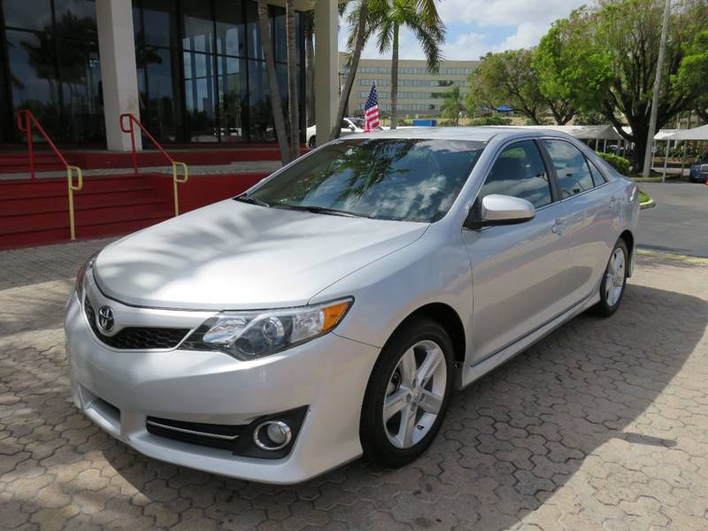 2014 TOYOTA CAMRY SE 4DR SEDAN silver the showroom miami is a family owned first class used car