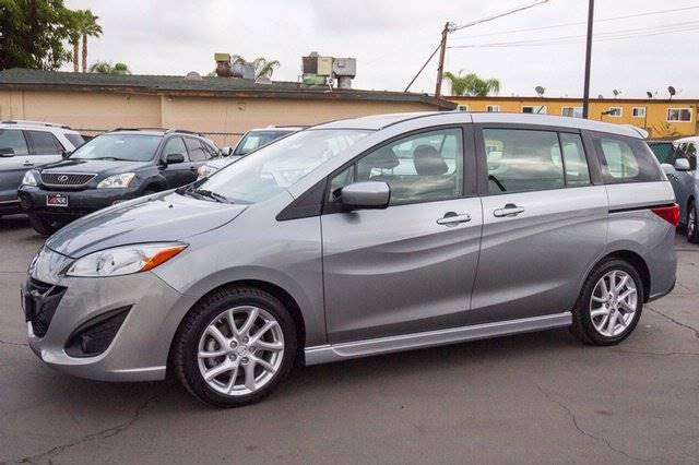 2012 MAZDA MAZDA5 SPORT 4DR MINI VAN 5A silver the showroom miami is a family owned first class