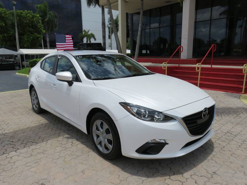2015 MAZDA MAZDA3 I SPORT 4DR SEDAN 6A white the showroom miami is a family owned first class us