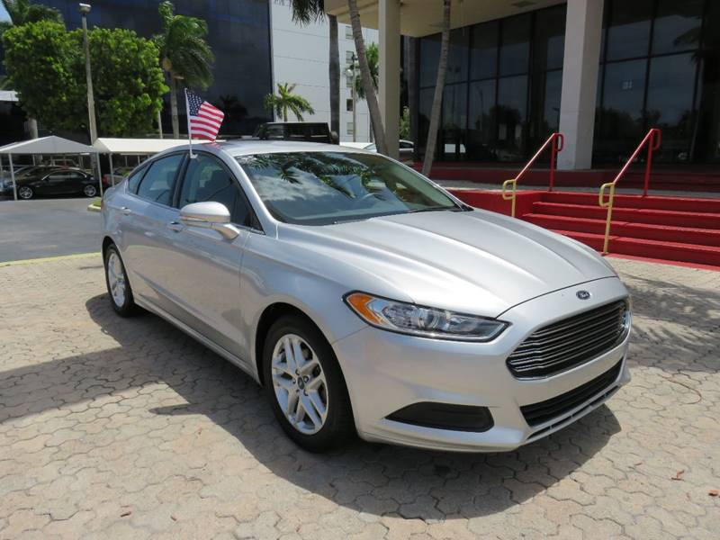 2014 FORD FUSION SE 4DR SEDAN silver the showroom miami is a family owned first class used car d