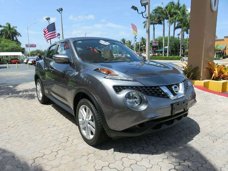 2015 NISSAN JUKE S 4DR CROSSOVER gray the showroom miami is a family owned first class used car