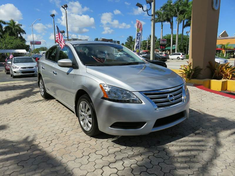2015 NISSAN SENTRA S 4DR SEDAN CVT silver the showroom miami is a family owned first class used