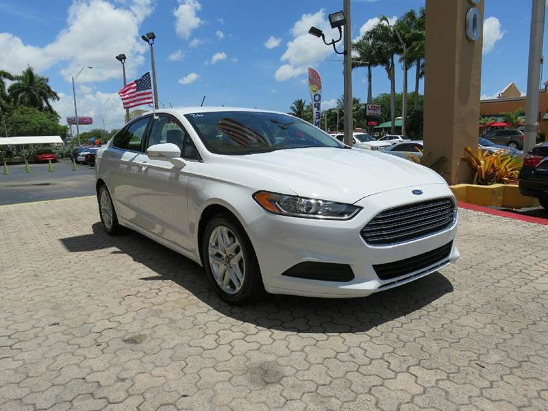2015 FORD FUSION SE 4DR SEDAN white the showroom miami is a family owned first class used car de