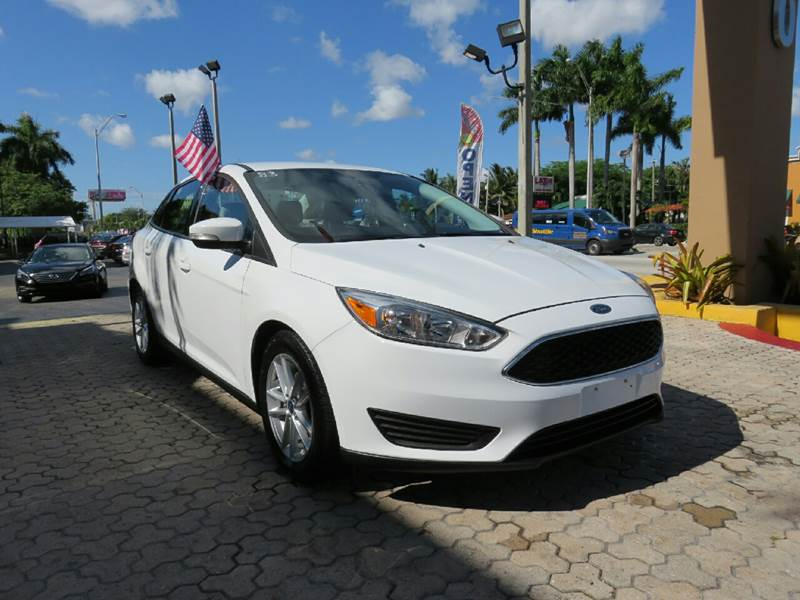 2015 FORD FOCUS SE 4DR SEDAN white the showroom miami is a family owned first class used car dea