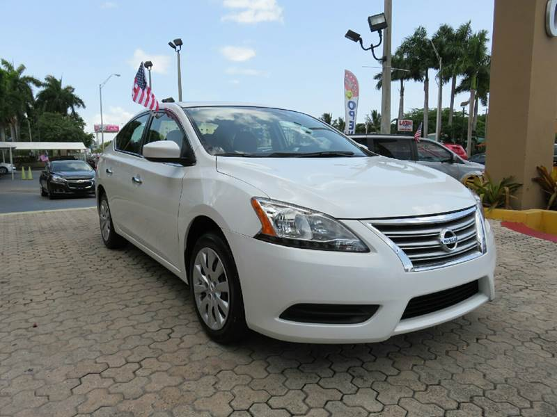 2014 NISSAN SENTRA S 4DR SEDAN CVT white the showroom miami is a family owned first class used c