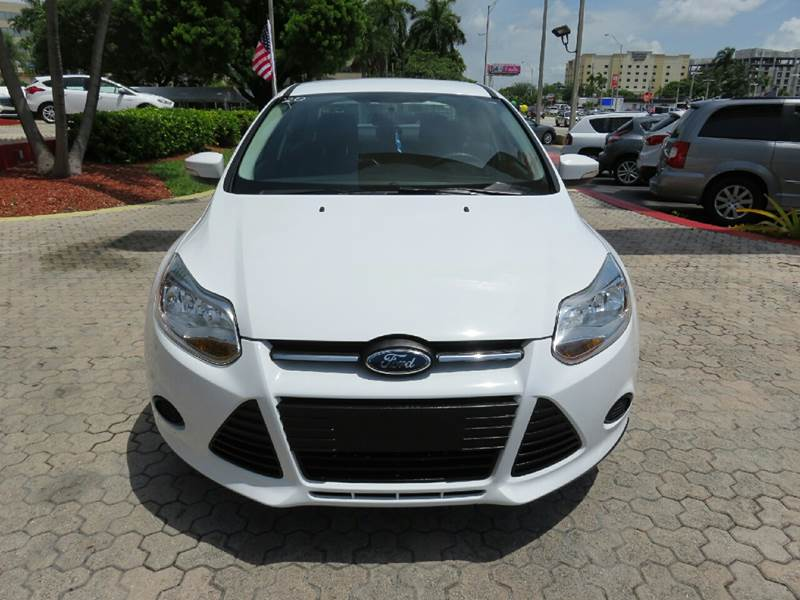 2014 FORD FOCUS SE 4DR SEDAN white the showroom miami is a family owned first class used car dea