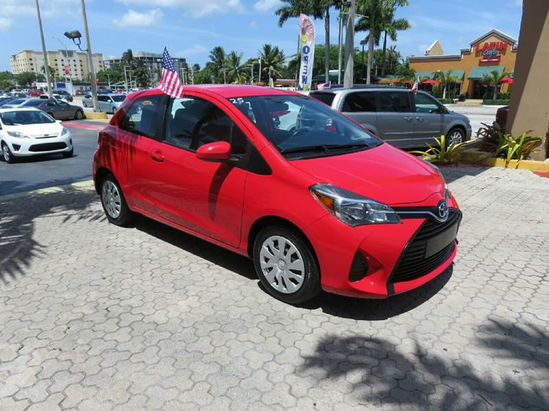 2015 TOYOTA YARIS 3-DOOR LE 2DR HATCHBACK red the showroom miami is a family owned first class u