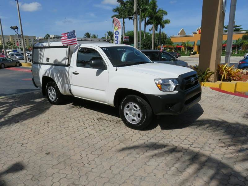 2014 TOYOTA TACOMA BASE 4X2 2DR REGULAR CAB 61 FT white the showroom miami is a family owned fi