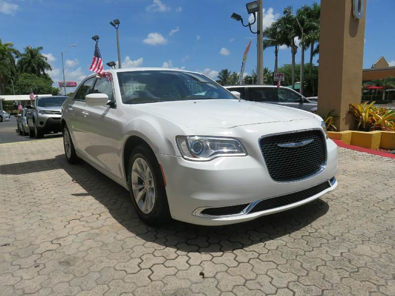 2015 CHRYSLER 300 LIMITED 4DR SEDAN white the showroom miami is a family owned first class used