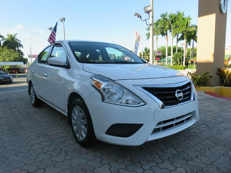 2015 NISSAN VERSA 16 SV 4DR SEDAN white the showroom miami is a family owned first class used c