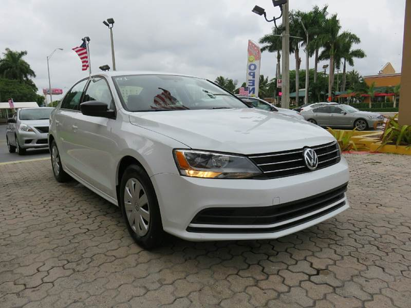 2015 VOLKSWAGEN JETTA S 4DR SEDAN 6A white the showroom miami is a family owned first class used