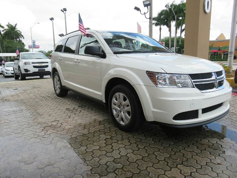2014 DODGE JOURNEY SE 4DR SUV white the showroom miami is a family owned first class used car de