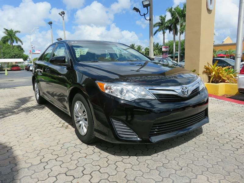 2014 TOYOTA CAMRY LE 4DR SEDAN black the showroom miami is a family owned first class used car d