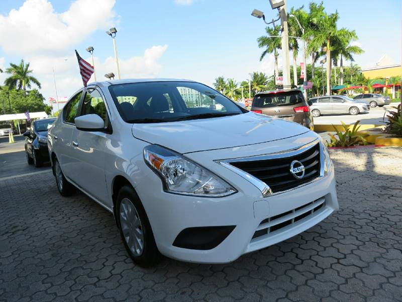 2015 NISSAN VERSA 16 S 4DR SEDAN 4A white the showroom miami is a family owned first class used