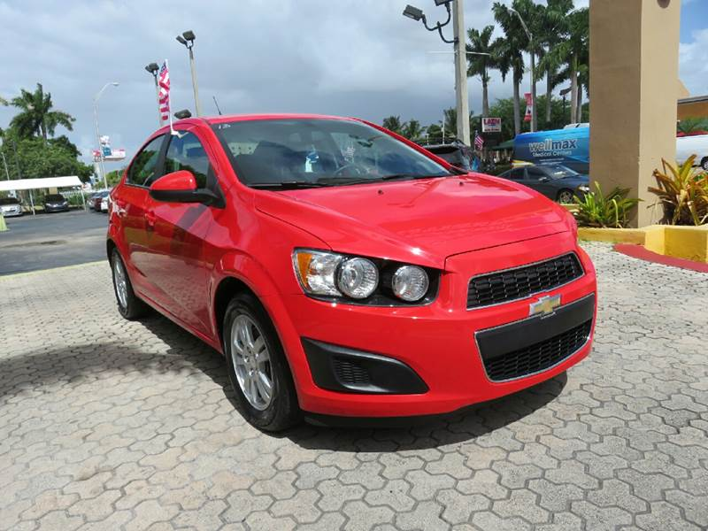 2014 CHEVROLET SONIC LT AUTO 4DR SEDAN red the showroom miami is a family owned first class used