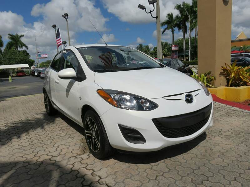 2014 MAZDA MAZDA2 SPORT 4DR HATCHBACK 4A white the showroom miami is a family owned first class