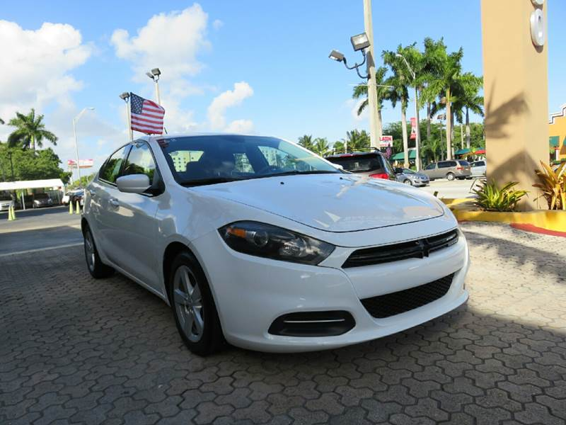 2015 DODGE DART SXT 4DR SEDAN white the showroom miami is a family owned first class used car de