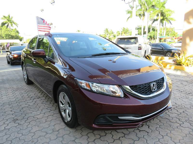 2014 HONDA CIVIC LX 4DR SEDAN CVT burgundy the showroom miami is a family owned first class used