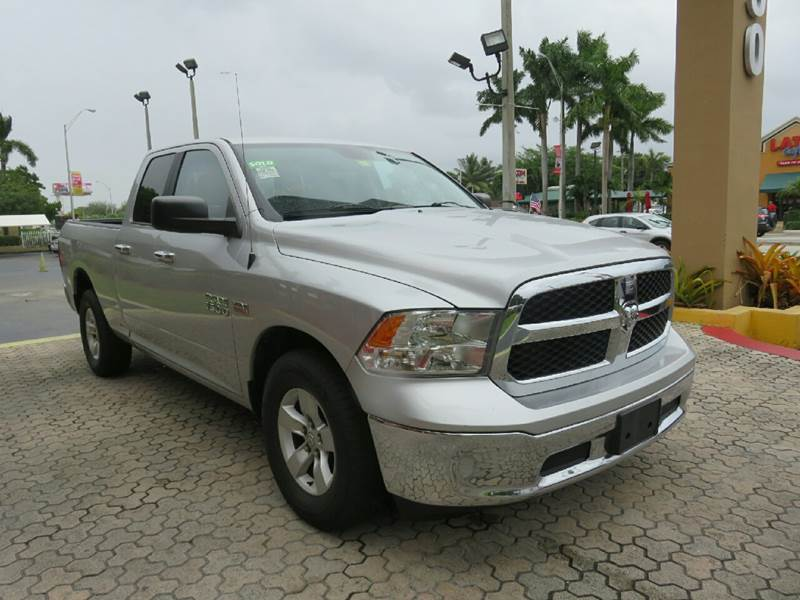 2014 RAM RAM PICKUP 1500 SLT 4X2 4DR QUAD CAB 63 FT SB silver the showroom miami is a family own