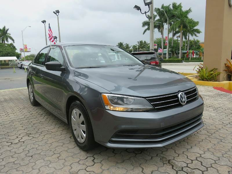 2015 VOLKSWAGEN JETTA S 4DR SEDAN 6A gray the showroom miami is a family owned first class used