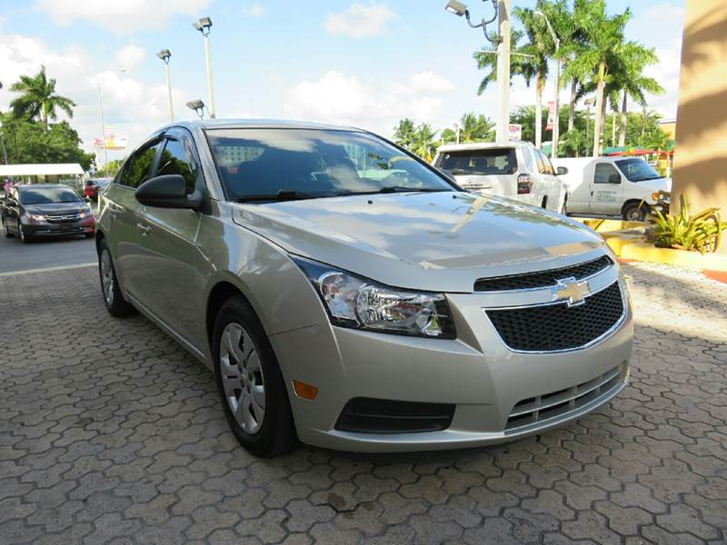 2014 CHEVROLET CRUZE LS MANUAL 4DR SEDAN W1SA gold the showroom miami is a family owned first c