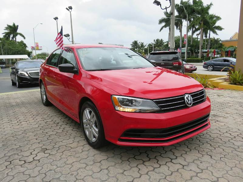2015 VOLKSWAGEN JETTA S 4DR SEDAN 6A red the showroom miami is a family owned first class used c