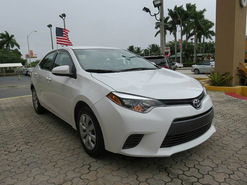 2015 TOYOTA COROLLA LE 4DR SEDAN white the showroom miami is a family owned first class used car