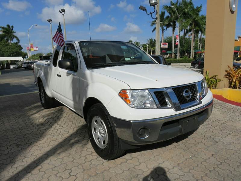 2010 NISSAN FRONTIER SE 4X2 4DR KING CAB PICKUP 5A white the showroom miami is a family owned fi