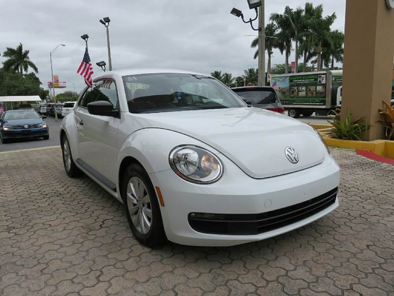 2015 VOLKSWAGEN BEETLE 18T CLASSIC PZEV 2DR HATCHBACK white the showroom miami is a family owned