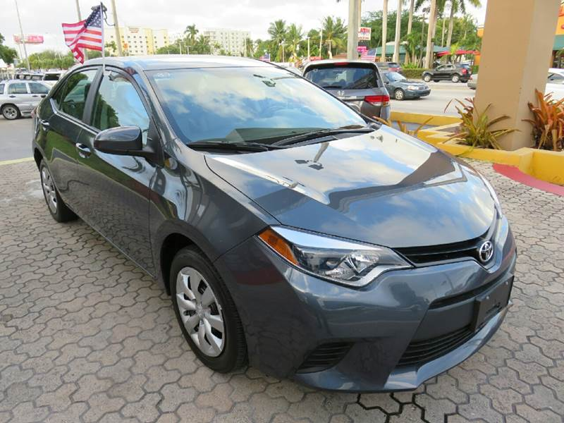 2014 TOYOTA COROLLA LE 4DR SEDAN gray the showroom miami is a family owned first class used car
