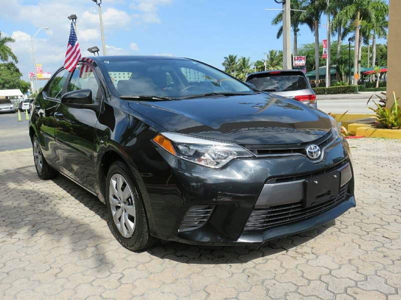 2015 TOYOTA COROLLA LE 4DR SEDAN black the showroom miami is a family owned first class used car