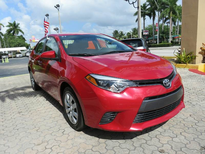 2015 TOYOTA COROLLA LE 4DR SEDAN red the showroom miami is a family owned first class used car d