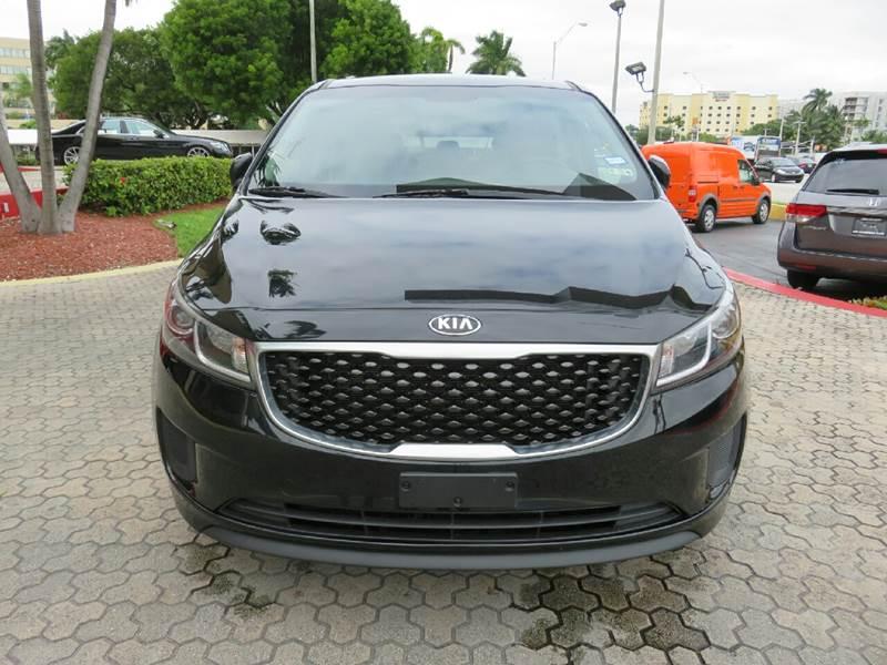 2015 KIA SEDONA LX 4DR MINI VAN black the showroom miami is a family owned first class used car