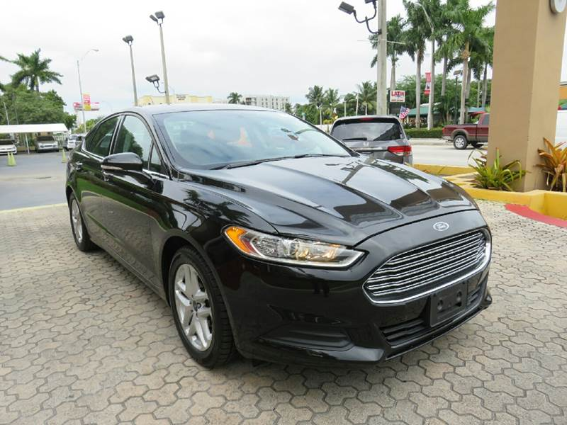2014 FORD FUSION SE 4DR SEDAN black the showroom miami is a family owned first class used car de