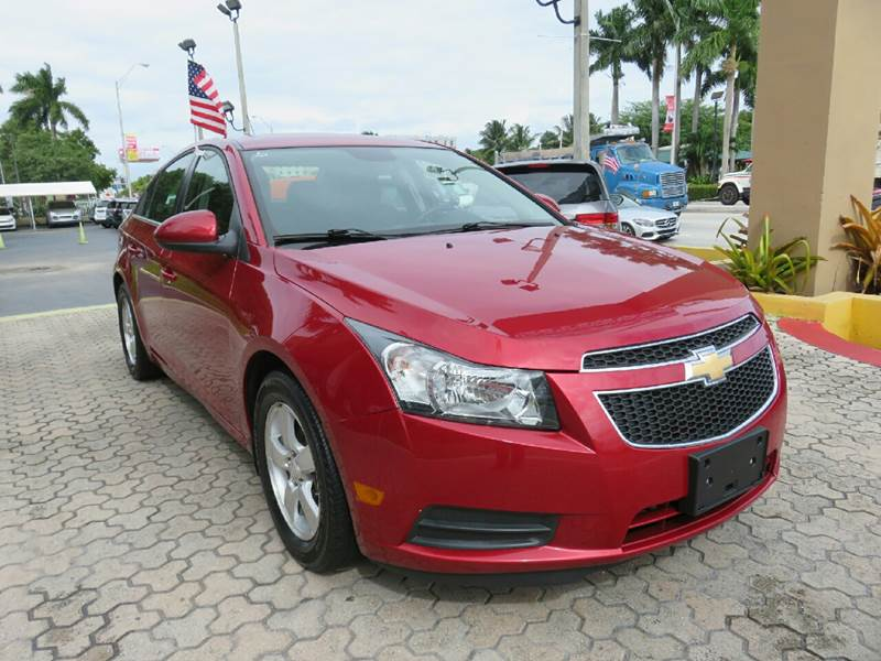 2012 CHEVROLET CRUZE LT 4DR SEDAN W1LT red the showroom miami is a family owned first class use