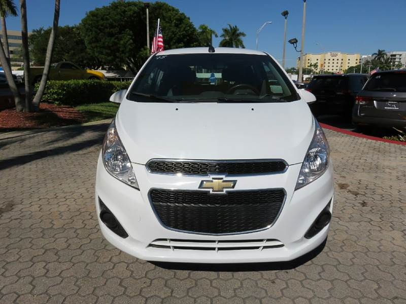 2014 CHEVROLET SPARK 1LT CVT 4DR HATCHBACK white the showroom miami is a family owned first clas