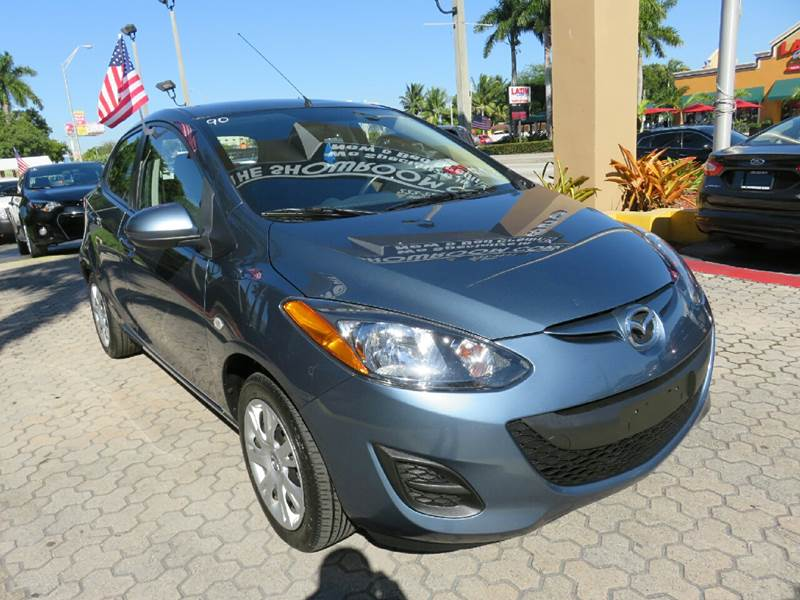 2014 MAZDA MAZDA2 SPORT 4DR HATCHBACK 4A blue the showroom miami is a family owned first class u