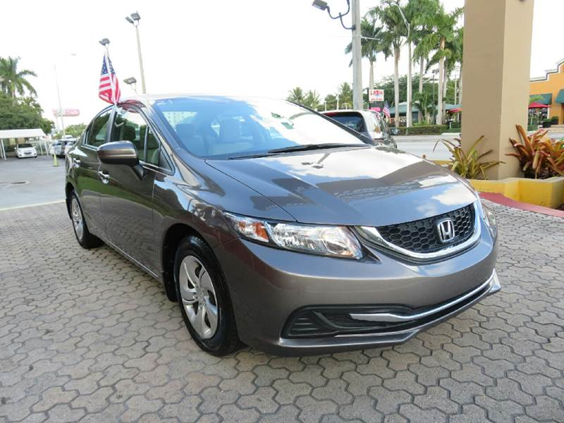 2014 HONDA CIVIC LX 4DR SEDAN CVT brown the showroom miami is a family owned first class used ca