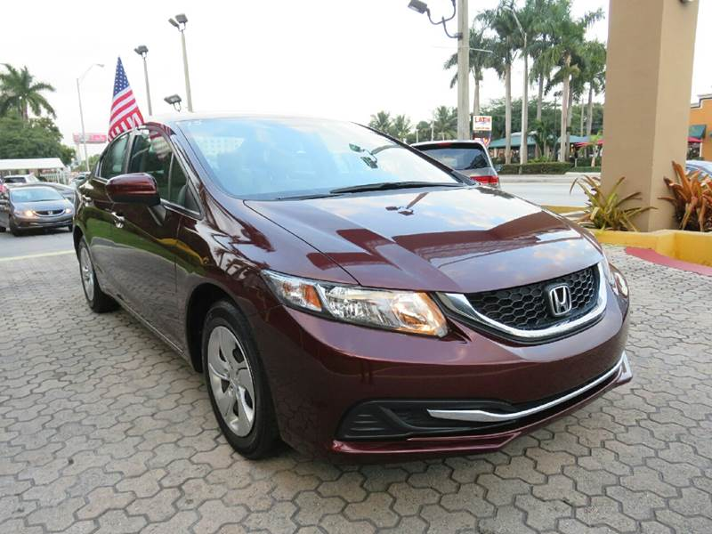 2015 HONDA CIVIC LX 4DR SEDAN CVT red the showroom miami is a family owned first class used car