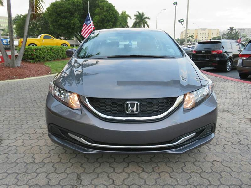 2015 HONDA CIVIC LX 4DR SEDAN CVT gray the showroom miami is a family owned first class used car