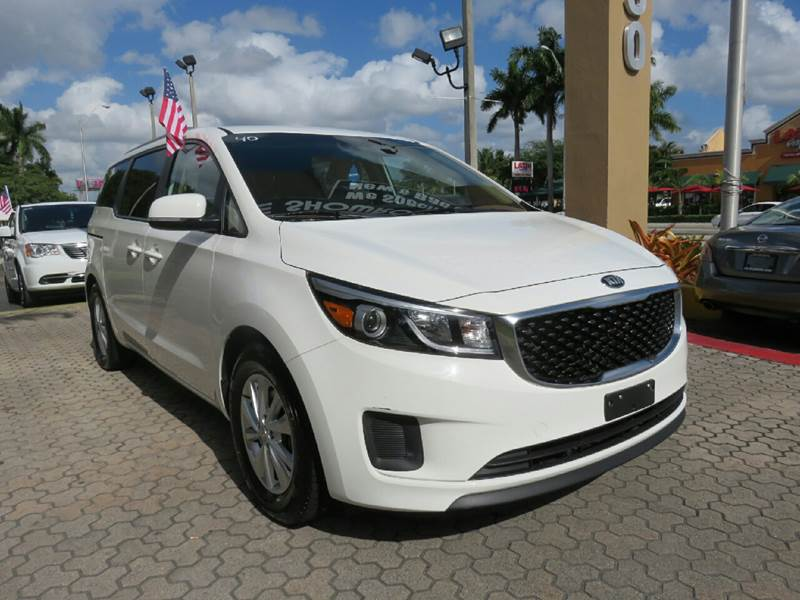 2015 KIA SEDONA LX 4DR MINI VAN white the showroom miami is a family owned first class used car
