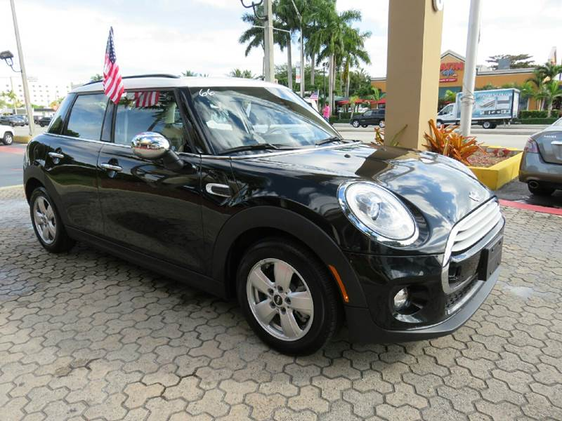 2015 MINI HARDTOP COOPER 4DR HATCHBACK black the showroom miami is a family owned first class us
