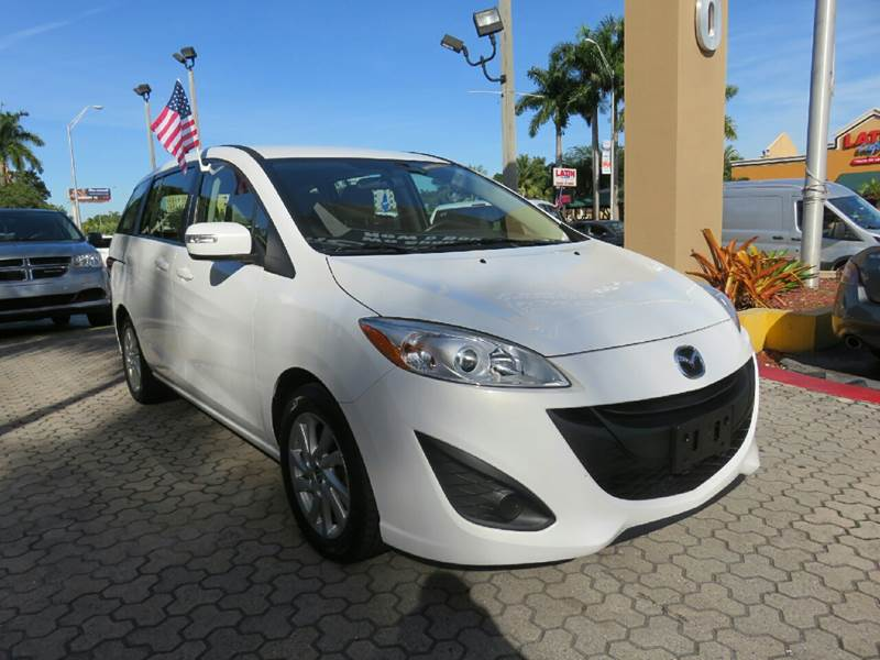 2015 MAZDA MAZDA5 SPORT 4DR MINI VAN white the showroom miami is a family owned first class used