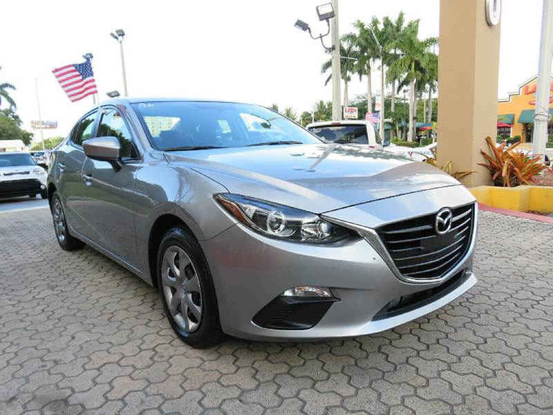 2015 MAZDA MAZDA3 I SPORT 4DR SEDAN 6A gray the showroom miami is a family owned first class use