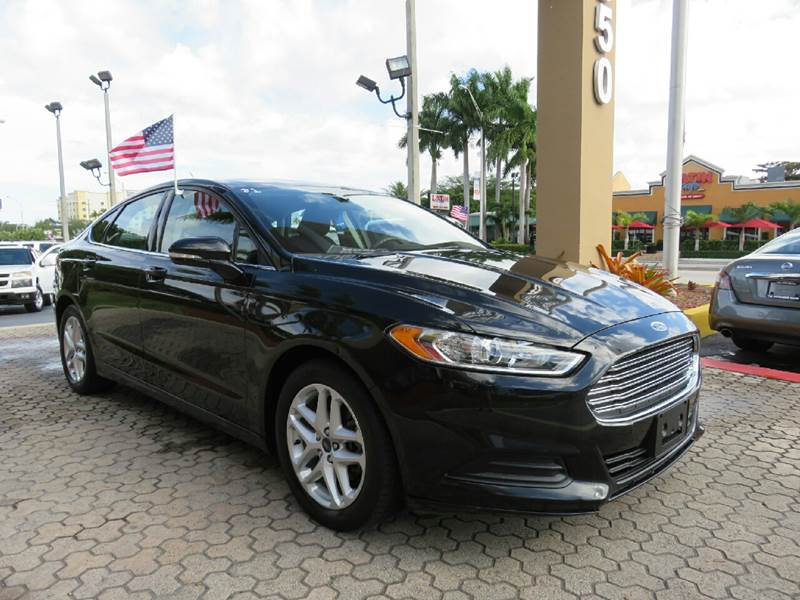 2015 FORD FUSION SE 4DR SEDAN black the showroom miami is a family owned first class used car de