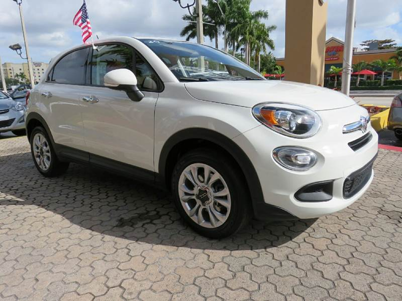 2016 FIAT 500X EASY 4DR CROSSOVER white fender lip moldings - accent headlight bezel color - chr