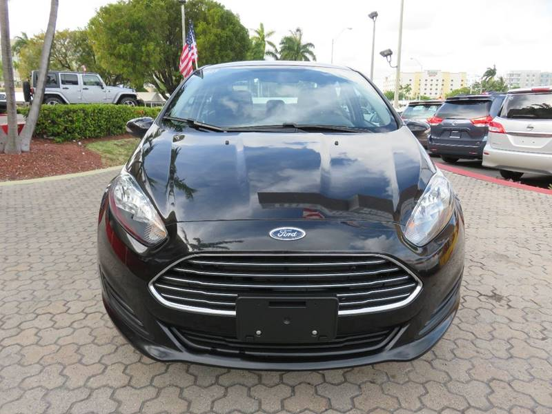 2015 FORD FIESTA SE 4DR SEDAN black headlight bezel color - black door handle color - body-color